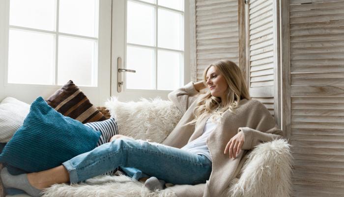 woman-laying-on-white-sofa